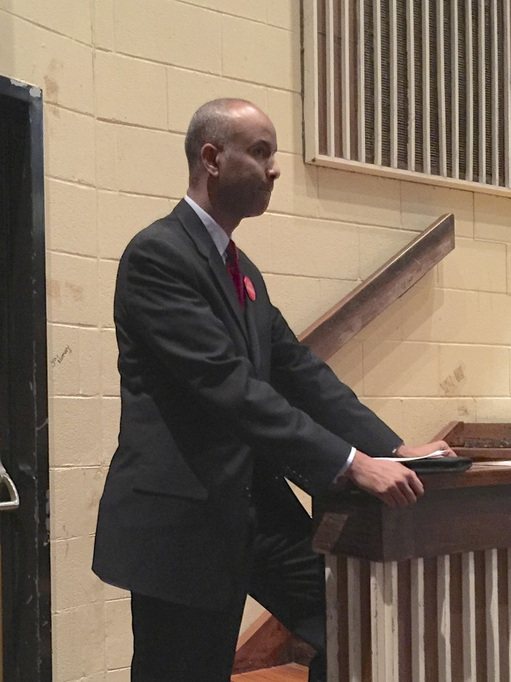 Ahmed Hussen waits to deliver his speech.